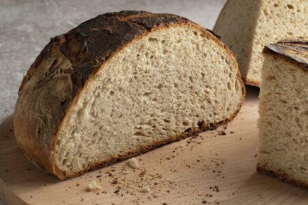 Fresh baked traditional sliced white German farmers bread isolated on white background Reklamní fotografie
