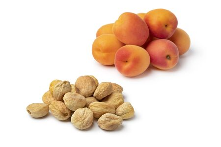 Heap of fresh and dried sweet orange apricots without preservatives isolated on white background Reklamní fotografie