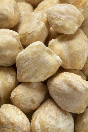 Whole peeled Asian kukui nuts close up full frame Reklamní fotografie