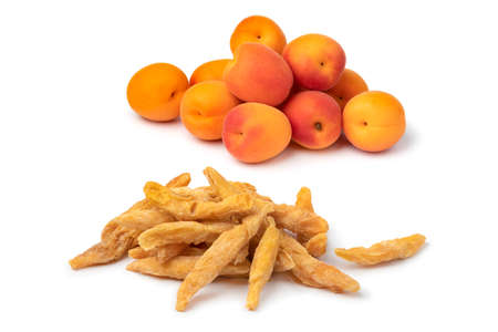 Heap of dried pitted sweet orange apricots, chapa namak, and fresh apricots isolated on white background Фото со стока
