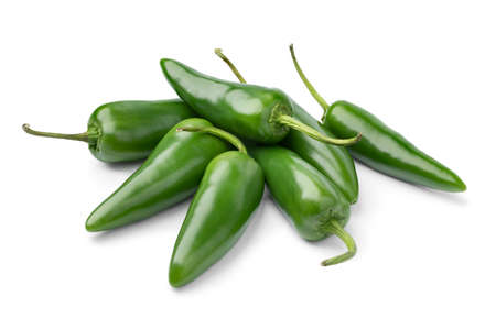 Heap of whole fresh raw green jalapeno peppers isolated on white background