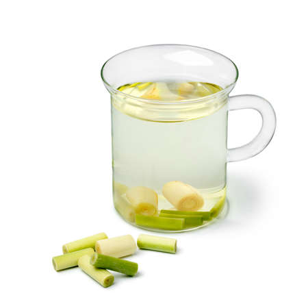Glass cup of refreshing lemongrass tea isolated on white background
