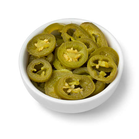 Bowl with sliced pickled jalapeno peppers isolated on white background