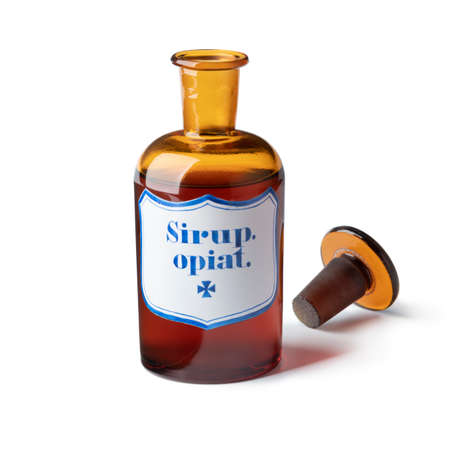 Historic old open pharmacy bottle with opium syrup isolated on white background