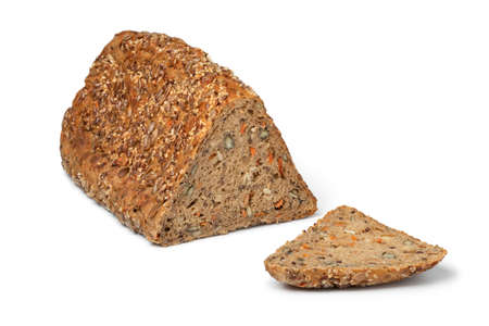 Fresh triangle loaf of German healthy rye seed bread and a slice isolated on white background