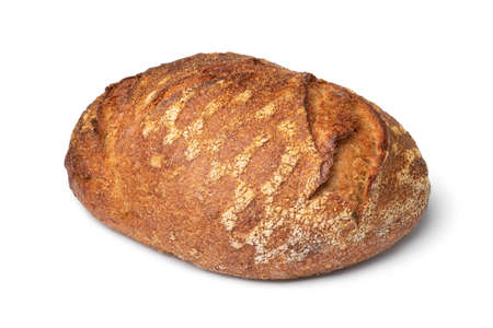 Single whole fresh baked German dinkel wheat bread isolated on white background Фото со стока