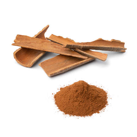 Dried Cinnamon bark and a heap of ground cinnamon powder isolated on white background