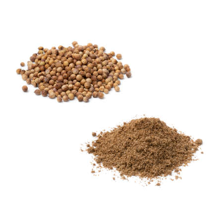 Heap of dried coriander seed and ground coriander isolated on white background