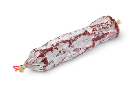 Single whole Rosette de Lyon, a French pork saucisson close up isolated on white background Фото со стока