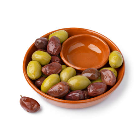 Bowl with Greek green and Kalamata olives close up for a snack isolated on white background