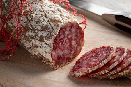 Fresh sliced Rosette de Lyon, a French pork saucisson close up