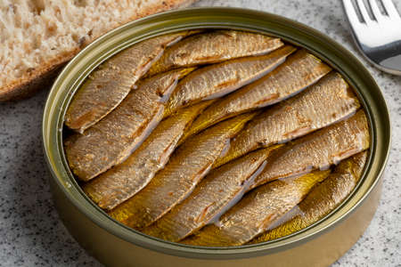 Canned smoked European sprat in oil for lunch close up