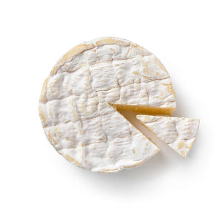 Traditional single French Camembert cheese and a piece seen from above isolated on white background