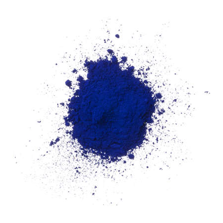 Heap of blue powder pigment isolated on white background Фото со стока