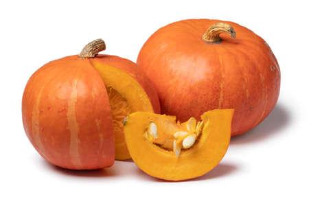 Orange whole Hokkaido pumkins and a piece isolated on white background Фото со стока