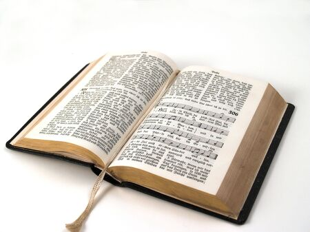 old open songbook with gilt edge isolated on a white background