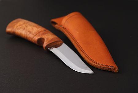 sheath: knife and leather sheath on black background