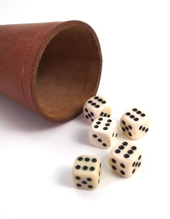 five dice and dice box on white background photo