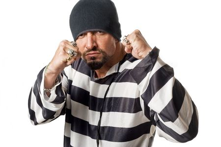 beanie: Man dressed in convict costume with rings and beanie