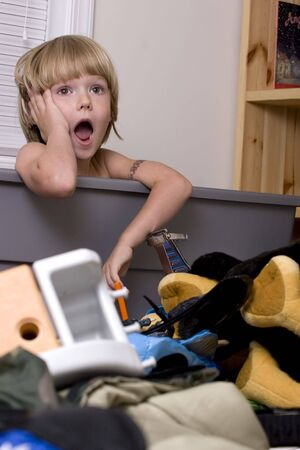 mess: Young boy who maid a mess in his room Stock Photo