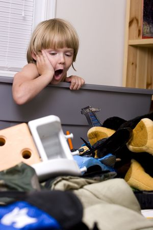 Young boy who maid a mess in his room Standard-Bild