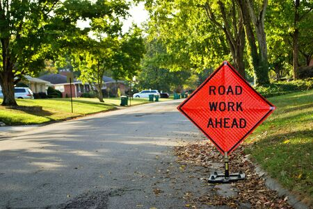 road work ahead construction sign in a residential neighborhood