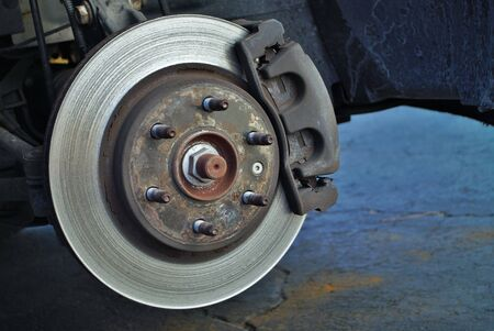 ruined disc brake rotor seen on a vehicle Imagens