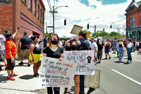 Dayton, Ohio, United States 05/30/2020 protesters at a black lives matter rally holding signs and wearing masks