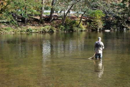 Unrecognizable old man fishing in the little river Gatlinburg Tennessee