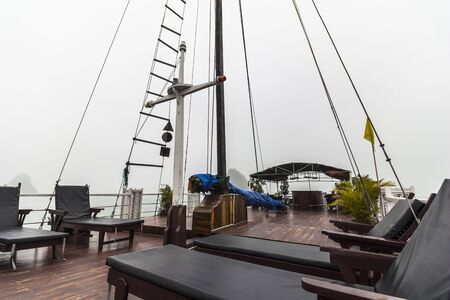 stateroom: On sundeck of boat in Halong Bay at foggy weather