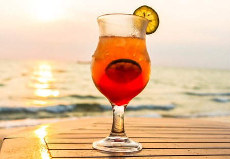 romantic sex: Colorful Sex on the beach Cocktail at sunset