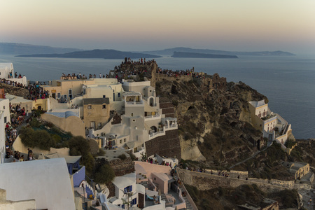 happening: Beautiful Sunset happening at the town of Oia in Santorini, Greece