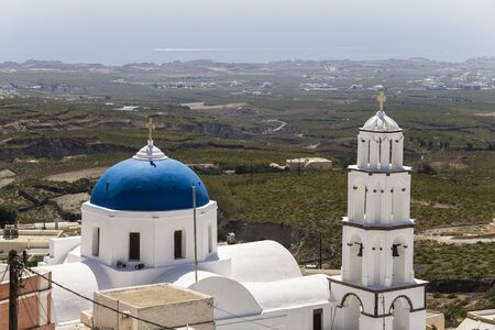 White church in front of Santorinis landscape, Greece Stock Photo