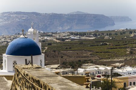 aegean: White church in front of Santorinis landscape, Greece Stock Photo