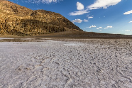 shaddow: On white salt inside Death Valley at extreme heat, California, USA