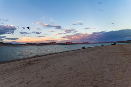 gunsight: Colorful sunset over sand at Lake Powell, Arizona, USA Stock Photo