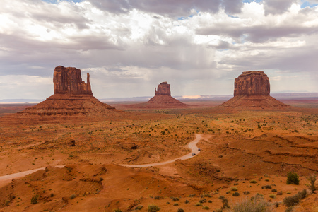 monument valley view: Monument Valley view in the afternoon with cloudy sky Stock Photo