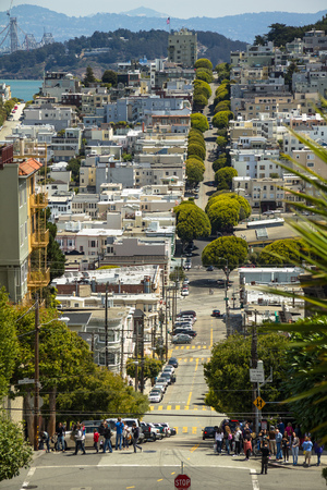 downhill: Long downhill street in San Francisco at daytime
