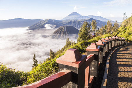 otherworldly: Way to viewpoint at Mount Bromo with clouds, Indonesia Stock Photo