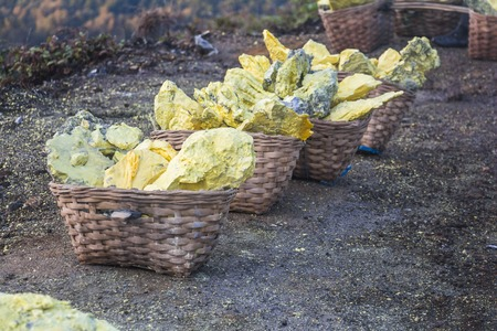 Sulfur in baskets from Ijen volcano on Java, Indonesia