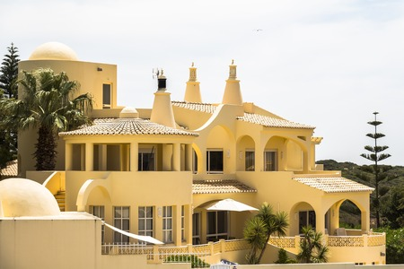 rooftile: Typical yellow house in Algarve region of Portugal
