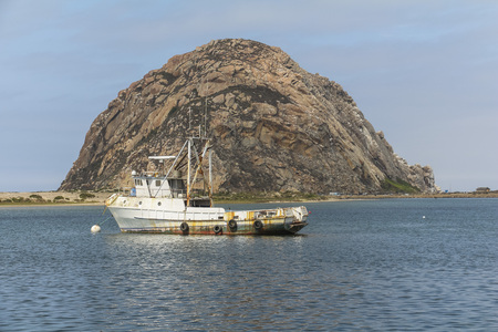 View on the Morro rock with ship in the foreground Stock Photo