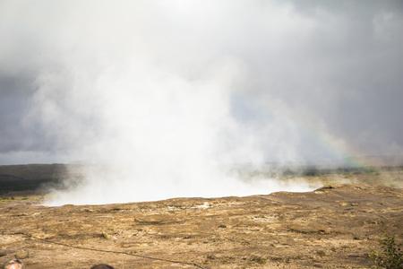 Geysir Strokkur in Iceland erupts at sunshine