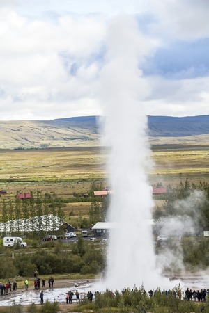Geysir Strokkur in Iceland erupts with tall fountain