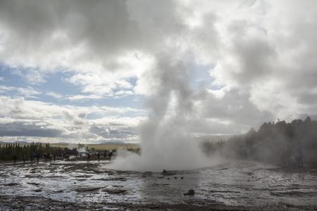 Geysir Strokkur in Iceland erupts on cloudy day