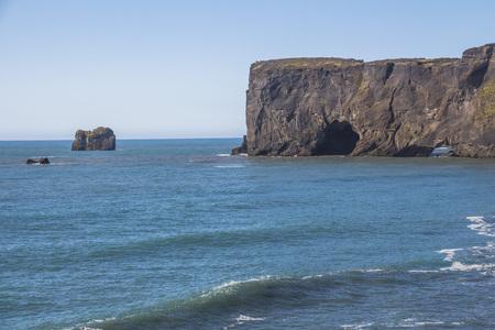 Stone arch view near Kirkjufjara beach, Iceland