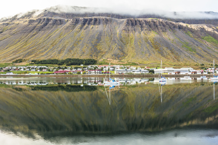 Fjord reflection on the water at Isafjordur, Iceland Stock Photo
