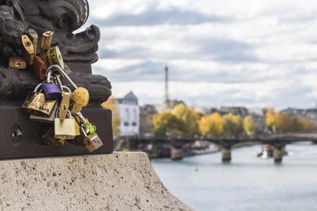 Padlocks on bridge over Seine river in Paris Stock Photo