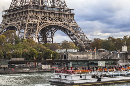 Tourist boat on Seine river with Eiffel tower, Paris Stock Photo