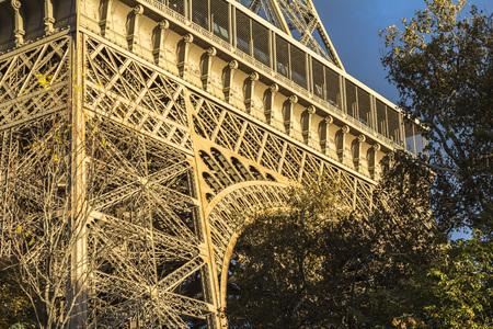 View on Eiffel tower, dark clouds and sunshine, Paris Stock Photo